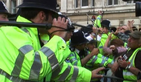 >Savage Police Baton Protestors at Anti-Bush Demo
