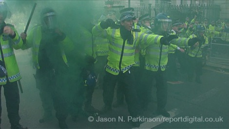 Police clash with anti government protestors outside Downing Street. Riot police were met with multiple missiles and smoke grenades during the fighting. 17 people were arrested.